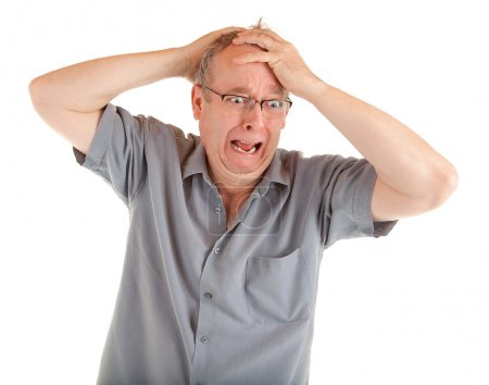 Photo for Man holding his head in disbelief and shocked just got very bad news. - Royalty Free Image