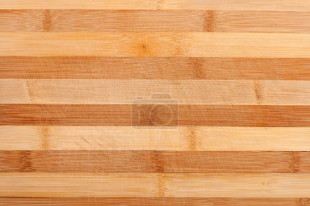 Photo for Wooden cutting board with scratches from knife - Royalty Free Image