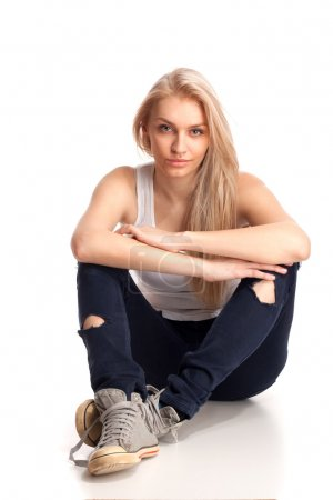Blond teenage girl sitting