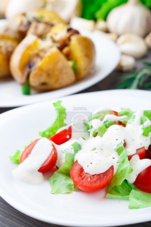Photo for Tomato and lattuce salad on a plate - Royalty Free Image