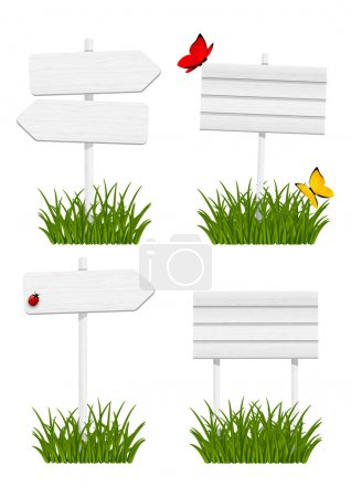 Illustration for Set of wooden signboards in green grass - Royalty Free Image