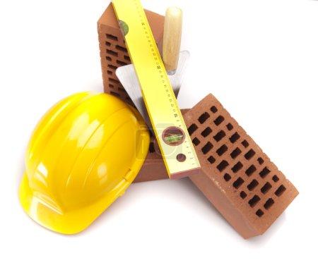 Building background, trowel and bricks