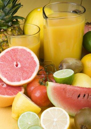 Orange drink and fruits