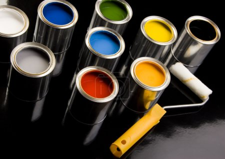 Cans of paint and roller