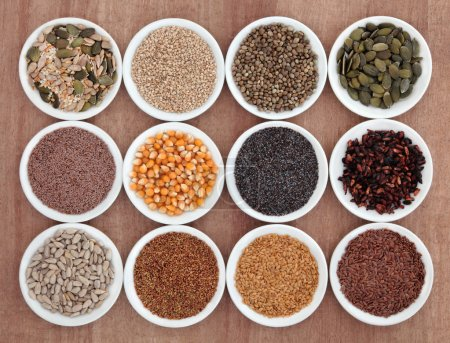 Photo for Seed food selection in porcelain bowls over papyrus background. - Royalty Free Image