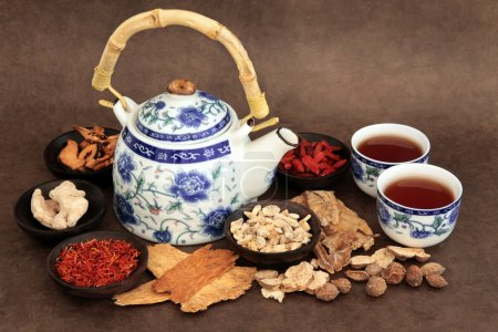 Chinese herb tea selection with traditional teapot...