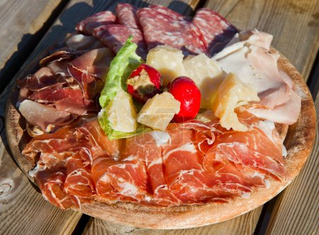 a platter of mixed cured meats, cheese