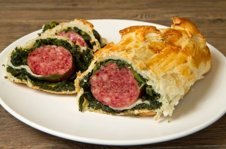 italian cotechino in crust with spinach