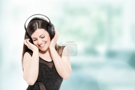 Photo for Beautiful brunette woman with headphones listen to music - Royalty Free Image