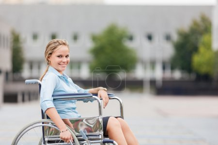 Photo for Photo of smiling businesswoman on wheelchair - Royalty Free Image