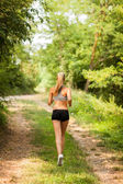 Beautiful blonde woman is doing running workout