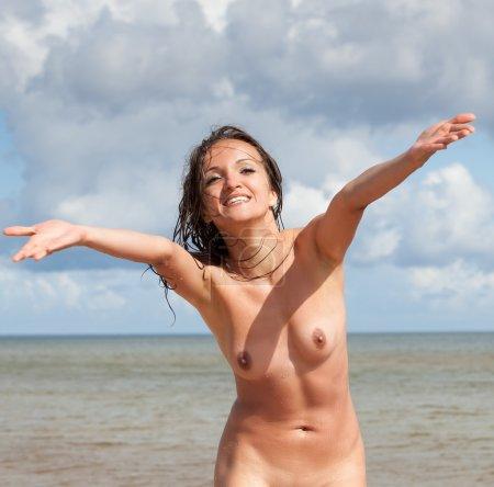 Nude woman on the beach