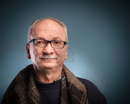 Photo for An elderly man with glasses looks skeptically - Royalty Free Image