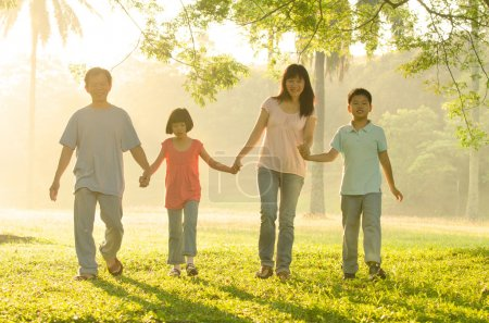 Photo for Asian family walking in the park - Royalty Free Image