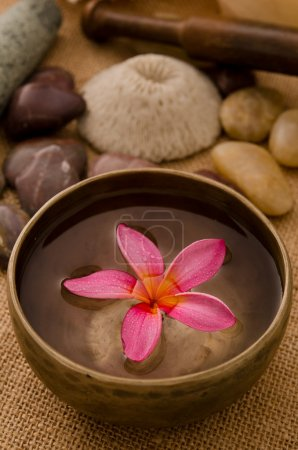 Tropical spa setup with frangipani flower