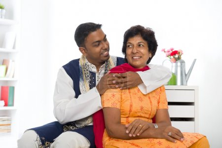 indian family of mother and son with traditional punjab dress li
