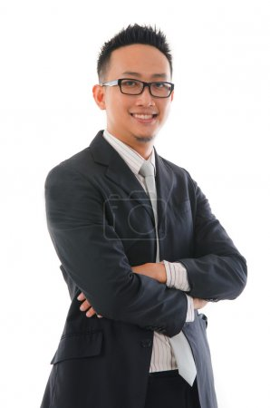 chinese man in full formal wear and smiling
