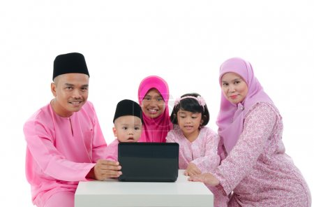 Malay family with traditional maalysian traditional clothes and
