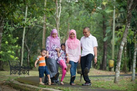 Happy indonesian Family enjoying family time playing together in