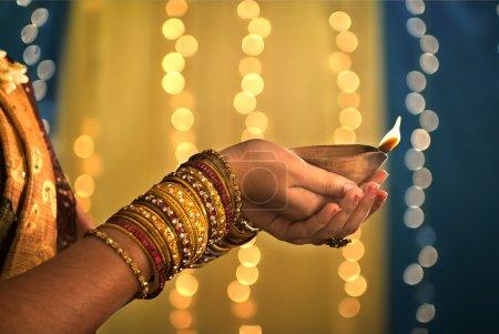 Diwali festival of lights , hands holding indian o...