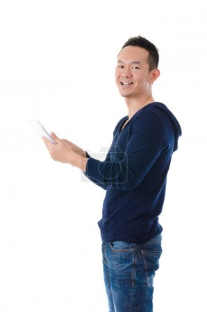 Asian man holding a digital touch screen tablet computer on whit