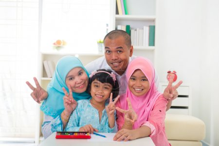 Malaysian malay muslim family learning together wi...