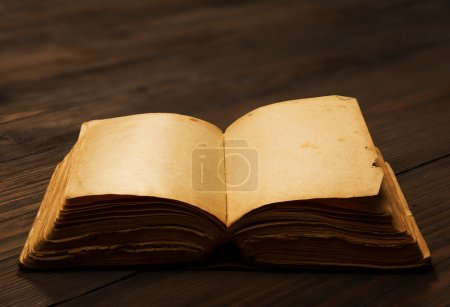 Photo for Old book open blank pages, empty yellow paper on brown wooden table, knowledge concept - Royalty Free Image