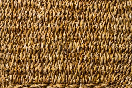 Cesta trenza de mimbre tejido textura, paja caña macro fondo