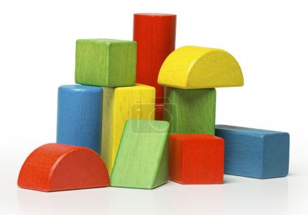 Toy wooden blocks, multicolor building bricks isolated over white background
