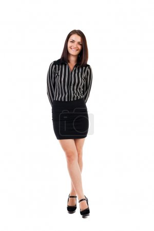 Young businesswoman standing with crossed legs