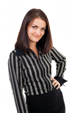 Happy young businesswoman standing with hand on hip