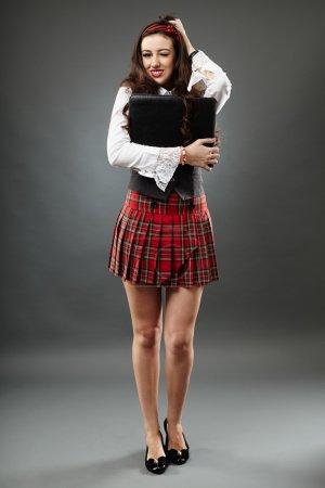 Full length of a funny schoolgirl