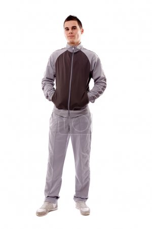 Photo for Young man in track-suit and sneakers in full length pose, isolated on white background - Royalty Free Image