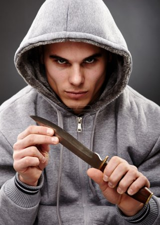 Closeup portrait of a threatening mafia man, holdi...