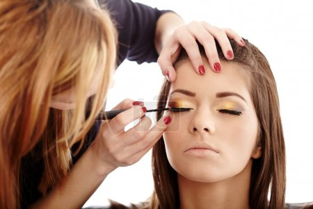 Photo for Closeup of a makeup artist applying makeup - Royalty Free Image