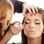 Closeup of a makeup artist applying makeup...