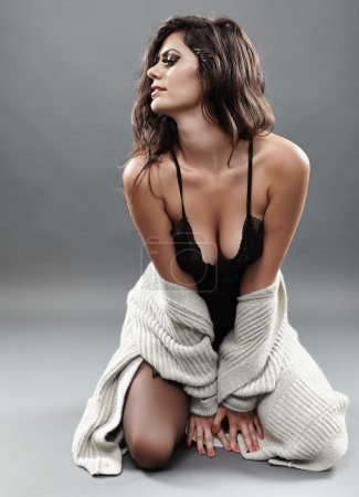 Sexy woman in black lingerie and cardigan