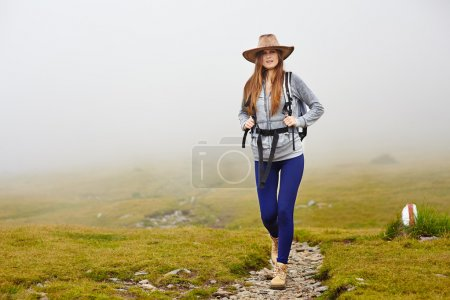 Female hiker on a mountain trail