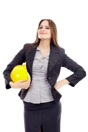 Female engineer holding helmet