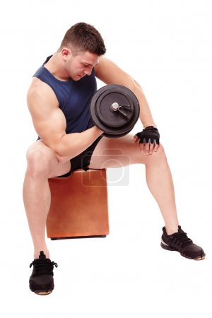 Handsome man working with heavy dumbbells