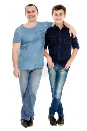 Studio shot of happy father and son