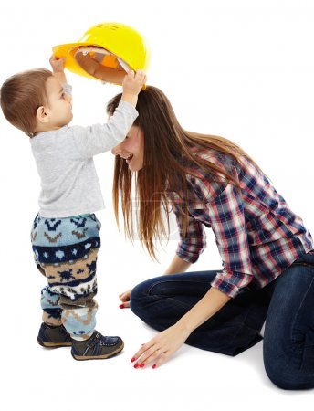 "Mother playing with her son ""construction worker"""