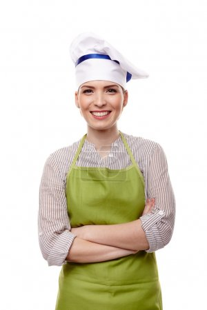 Smiling woman cook with arms folded