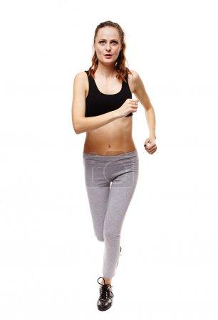 Photo for Full length studio shot of an athletic young woman running isolated over white background - Royalty Free Image