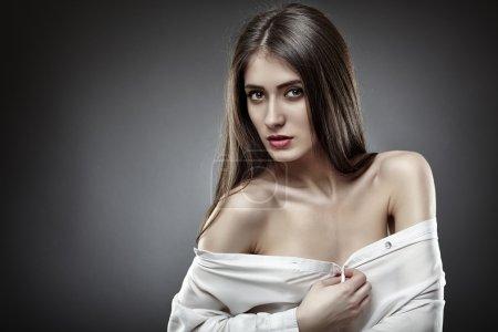 Beautiful glamour woman on gray background