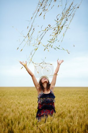 Photo for A happy caucasian young and beautiful woman in a wheat field - Royalty Free Image