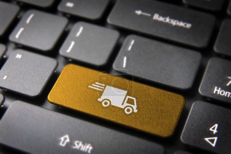 Photo for Transport delivery key with truck icon on laptop keyboard. Included clipping path, so you can easily edit it. - Royalty Free Image