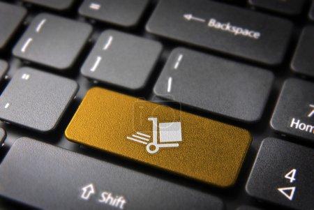 Gold Shipping cart keyboard key, Business background