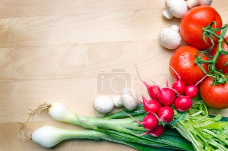 Photo for Wooden cutting board with vegetables - Royalty Free Image