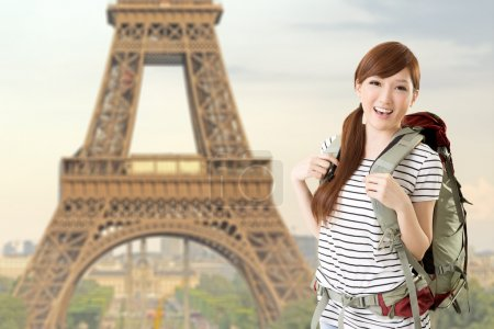 Photo for Happy smiling Asian woman travel and look at you in front of famous landmark, Eiffel tower in Paris, France. - Royalty Free Image
